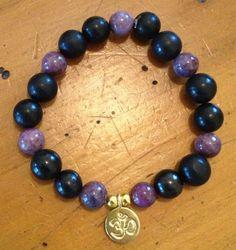 Shungite and Lapidolite Bracelet with Gold Vermeil OM Charm (charm also in silver)  $38.99 https://www.facebook.com/CrystalBlissJewellery?ref=hl