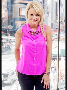 "You can't miss her! Miranda Lambert, who released her ""Somethin' Bad"" music video with Carrie Underwood on Wednesday, stands out in neon pink while appearing on Extra in New York's Times Square on Thursday."