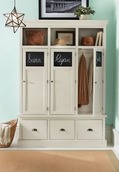 With a household full of kids, a storage locker like this in the mudroom isn't a bad idea! Chalkboard panels allow for easy labeling of each section of the storage locker. Two hooks hang behind each door to hold jackets and scarves. Cubby space and drawers complete the look. Available at Home Decorators Collection.