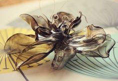 how to make spoon flowers, crafts, I used several different types of spoons This one was so pretty with its smoky gray transluscence that I chose not to paint it it looks like blown glass right