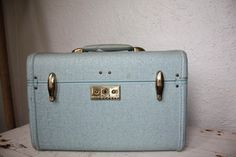 The Powder Blue Suitcase. Check out Morgan's review of Lisa Graff's A Tangle Of Knots here: http://chaptersandscenes.wordpress.com/2014/02/13/morgan-reviews-a-tangle-of-knots/