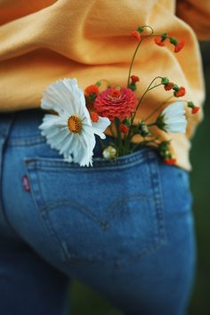 For a cute back profile picture with hands swinging, put flowers in back pocket for a cute extra detail