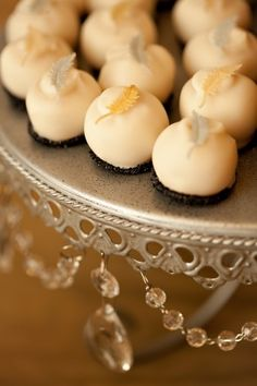 White chocolate truffles with gold feather accents... Wedding favors or just a late night snack?