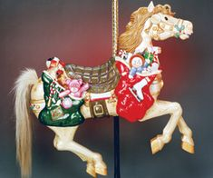 SANTA'S PONY Adoptive family: Terry McGillis Family, Dale Moore Family, Tim Browne Family My story: The pony was adopted at the Carousel's fund raising auction in April of 1994. Santa's Pony is an outside row replacement pony, and rides the Carousel each winter to celebrate the magic of Christmas.