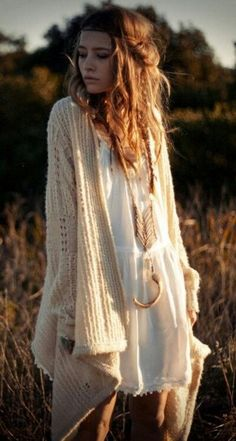 long oversized beige sweater, white flowy dress, long bone and native style necklace, braided messy wavy hair, bohemian, boho chic outfit