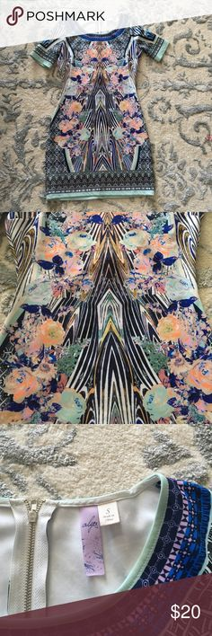 Cute boutique dress! Worn once dress! it is form fitting, almost made out of a neoprene material!! No stains or smells! Smoke free home!!! Dresses Midi