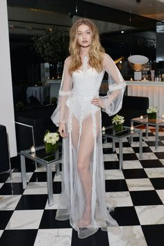 March 20, 2016 March 20, 2016 Supporting her sister Bella at the Daily Front Row L.A. Fashion Awards, Hadid made quite the statement in a white corset layered underneath a sheer gown overlay with leaf and fringe embroidery.