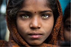 Piercing Eyes In the small lanes of Udaipur, around the Jagdish Temple, there were about a hundred people waiting for donation. Somehow, in the middle of the crowd, this girl's eyes captured me. Through her eyes we see life, dreams, faith, hope, but more than all, we see beauty. Maira Fridman http://cargocollective.com/mairafridman/