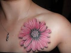 What does daisy tattoo mean? We have daisy tattoo ideas, designs, symbolism and we explain the meaning behind the tattoo. Body Art Tattoos, New Tattoos, Tattoos For Guys, Sleeve Tattoos, Tattoos For Women, Tatoos, Tattoo Women, Aster Flower Tattoos, Birth Flower Tattoos