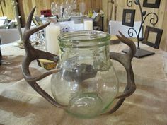 "Idea:  Use the small antlers with the large green glass jar as a vase or a spot to collect honeymoon funds.  Hunting theme.     ***** This is an example of how you might use our rustic props at Heart of Rock Farm.  To find the top-level board and look for specific props, search for the board called ""Rustic Wedding Props: Heart of Rock Farm"". Wedding Props, Wedding Decorations, Rustic Wedding, Our Wedding, Hunting Themes, Honeymoon Fund, Vase, Antlers, Glass Jars"