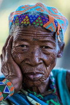 An elderly woman in the village of the San (or Saan) people, the oldest tribe in Africa -- by photographer Andrei Duman. We Are The World, People Around The World, Around The Worlds, African Love, African Art, Great Photos, Cool Pictures, Unity In Diversity, African Tribes
