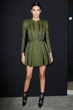 Kendall Jenner steps out in style with a leather Balmain dress paired with a black summer bootie. See how to get the look here!