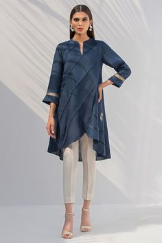 A solid overlapped Linen shirt in a shade of navy blue with pleated details. The perfect everyday look for stylish statement. Tunic Designs, Dress Neck Designs, Kurti Neck Designs, Kurta Designs Women, Stylish Dresses For Girls, Simple Dresses, Nice Dresses, Casual Dresses, Pakistani Dresses Casual