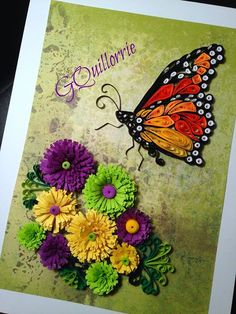 Butterfly hovering over flowers, quilled - by: Lorrie - Quilling Plus group-FB