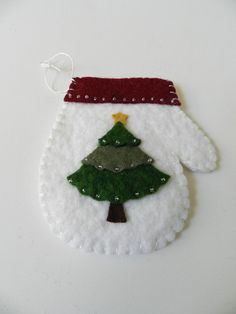 Handmade Christmas Wool Felt Ornament White Mitten by hollandvstk, $7.50.  I really like the round shape of this mitten, allowing for a nice, full tree to be appliqued on it.