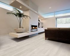 I\'m intrigued by this Daltile porcelain plank wood tiles. Links in ...