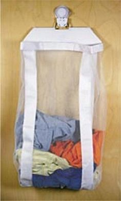 A Space-saving. wall-mounted laundry hamper, perfect for your RV! #RVLife #hamper Laundry Hamper, Bedside, Interior Decorating, Backpacks, Home Decor, Homemade Home Decor, Clothes Basket, Interior Home Decoration, Laundry Bin
