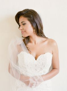 Scalloped lace embroidered bodice wedding gown: http://www.stylemepretty.com/little-black-book-blog/2015/11/20/elegant-austin-bridal-session/ | Photography: Mint Photography - http://mymintphotography.com/