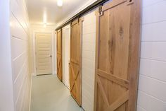 2 Barn doors on one wall for multiple rooms!