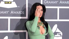 When Katy Perry hair flipped with her cleavage out. | The 16 Greatest Diva Moments At The Grammys