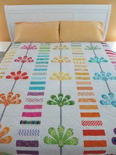 Flourishing Palms: A Bloomin' First 3Q Finish Quilt.