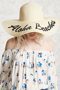 "A straw hat featuring an ""Aloha Beaches"" cursive embroidery, and a wide floppy brim."