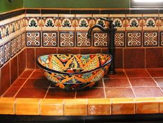 Pretty sink.  I like the tile vanity and trim.  I wonder if a bowl sink would take up too much room?  Maybe a drop-in sink would make the bathroom feel more spacious?