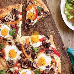 Breakfast Sausage-Egg Pizza | This creative brunch twist is a definite crowd-pleaser. Feel free to fry the eggs in a skillet and add to the just-cooked pizza. Don't worry about shaping a perfectly round pie—embrace the free-form look. | SouthernLiving.com
