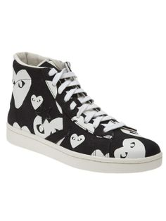 Black canvas 'Pro Star Hi' sneakers from Comme des Garçons Play for Converse featuring white ditsy hearts and a lace-up front. Has a round toe and a textured white rubber sole. Men - Comme Des Garçons Play X Converse 'Pro Star Hi' Sneakers - TRAFFIC LA