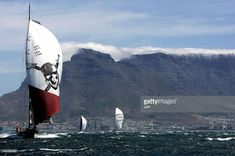 Pirates of the Caribbean (L) from USA, ABN Amro two(R) from The Netherlands and Movistar (C) from Spain race , 26 December 2005, in the Cape Town harbour race as part of the Volvo Ocean Race. ANB Amro one from the Netherlands won the race today.