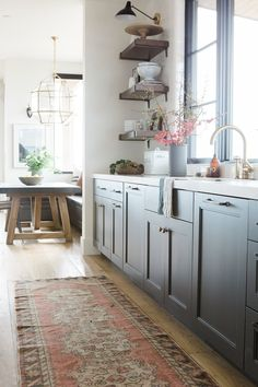 Open kitchen with dark cabinets and open shelving