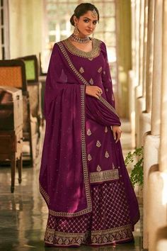 Embrace your love for fashion and inspire the rest with your uber-chic style as you wear this plum purple georgette sharara suit which will instantly catch your fancy. This u neck and full sleeve garment perfectly formed using zari and stone work. Present with georgette sharara pants in plum purple color with plum purple georgette dupatta. Sharara pants and dupatta are also designed using stone and zari work. #shararasuits #malaysia #Indianwear #weddingwear #andaazfashion Indian Attire, Indian Wear, Sharara Suit, Salwar Kameez, Pantalon Cigarette, Bollywood Dress, Plum Purple, Magenta, Pakistani Suits