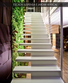 suspended stairs + vertical garden