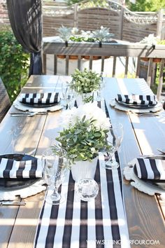 I love this table! Black and White Tablescape decor. www.settingforfour.com