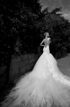 Beautiful twins model the new Galia Lahav wedding couture line for 2012. They carry crafted umbrellas with their long lace dresses, and pose against metal doors in pearls and white gowns oozing of tulle. The gowns are intricately beaded and embellished and look both Old World Hollywood and modern for today.They also model pale blue and violet gowns from the collection. (see more photos)