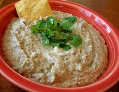 This is a Middle Eastern dip made of eggplants and tahini. Roasting the eggplants under a broiler or in the oven gives it a nice smokey flavor.
