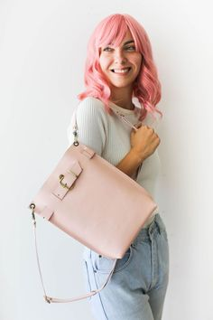 This gorgeous pastel pink leather bag is one of it's kind. Handcrafted from the finest Leather to last a lifetime. This purse has the most Minimalist design and Convertible features. It can easily be transformed into a backpack, Handbag and into a crossbody bag. Leather Backpack Purse, Crossbody Bag, Pink Design, Leather Bags Handmade, Pink Leather, Fashion Photography, Backpacks, Handbags, Purses