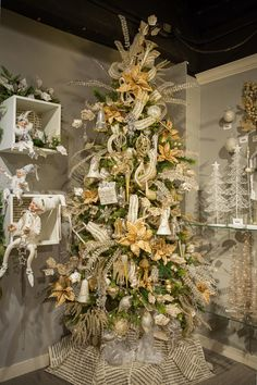 Celebrate the Season with gold and champagne color Christmas tree.