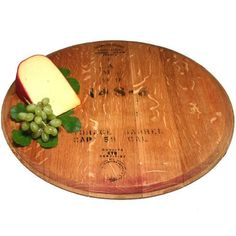 The Wine Barrel Lazy Susan is a lazy susan handcrafted in California's wine country from an authentic vintage oak wine barrel. An Old River Road Wine Barrel Lazy Susan is a wine cask top that rotates 360 degrees effortlessly. Each Wine Barrel Lazy Susan is made from a different wine cask barrel top branded with a vintner's stamp (wineries vary too), and hand rubbed with butcher's block oil and beeswax. The Old River Road Wine Cask Lazy Susan is a beautiful way to serve cheeses, hors…