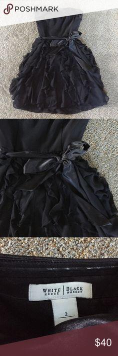 Black ruffle party dress Such a fun dress! Great ruffle texture bottom. Large bow ties around waist. White House Black Market Dresses Midi