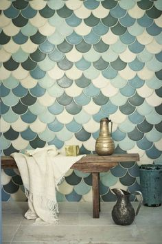 Fish scale tiles are a great way to update your kitchen or bathroom. Replace your subway tile with fish scale tile to stay on trend. For more design ideas and inspiration, go to Domino. Tiles, Bathroom Inspiration, Fish Scale Tile, Decor, Remodel, Interior, Wall And Floor Tiles, Tile Bathroom, Home Decor
