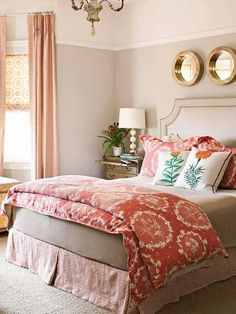 The pretty coral color in this bedroom is perfect for springtime don't you think?