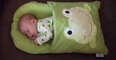 zCush Baby Nap Mat is for holding and safely passing your baby, a handy newborn sleeping bag, portable mat for picnic, for breast feeding on the go, and get a clean surface for changing diapers. The attached blanket keeps your infant warm.