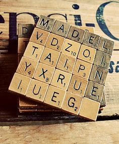 Scrabble tile coasters DIY tutorial - the link is missing, but I'm planning to hot glue tiles to felt. It would work with dominoes or rumikub tiles too.
