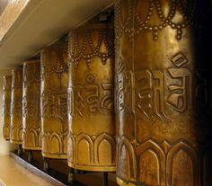 Brass prayer wheels surrounding the Tsuglagkhang Temple in McLeod Ganj