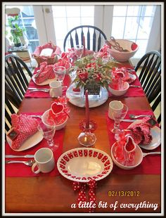Valentines day family table. Simple and effective use of red - could be found at the dollar store & thrift shops
