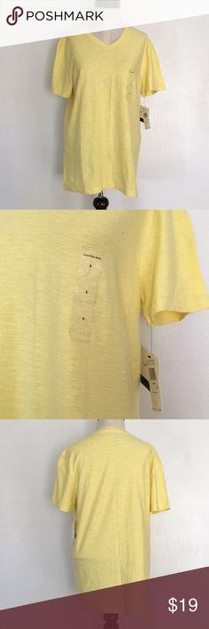 Calvin Klein jeans lemon ice men's small V-neck Calvin Klein men's small V-neck T-shirt color lemon ice brand new with tags Calvin Klein Jeans Shirts Tees - Short Sleeve