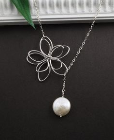 Sterling Silver Jewelry, Flower and Coin Pearl Necklace, Bridal jewelry, White Pearl Lariat, Silver Lariat, best friend gift. $28.50, via Etsy.
