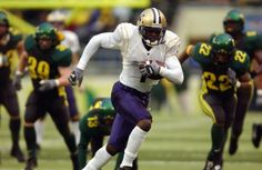 Wide Receiver Reggie Williams of the Washington Huskies scores a touchdown on this run in the fourth quarter against the Oregon Ducks during their...