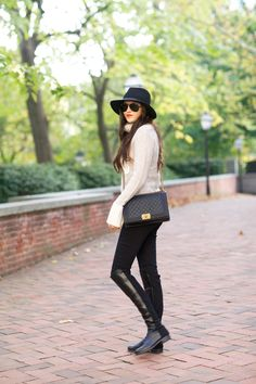 ivory Tory Burch sweater, black Hudson pants, black Stuart Weitzman 50/50 OTK boots, black Rag & Bone hat, black quilted Chanel bag